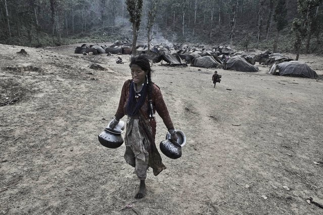 In the wet monsoon season the Raute people move to high altitudes and in dryer winters they migrate to lower subtropical forests in Accham District, Nepal, January 2016. (Photo by Jan Moller Hansen/Barcroft Images)