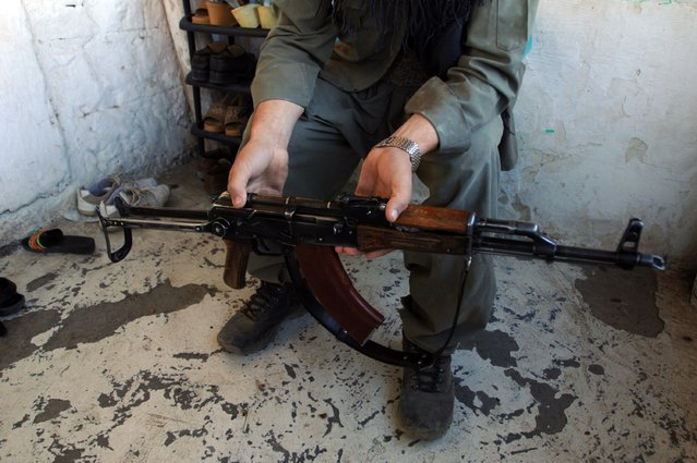A village guard show his AK-47 in the southeastern Turkish province of Sirnak, October 19, 2007. (Photo by Burak Kara/Getty Images)