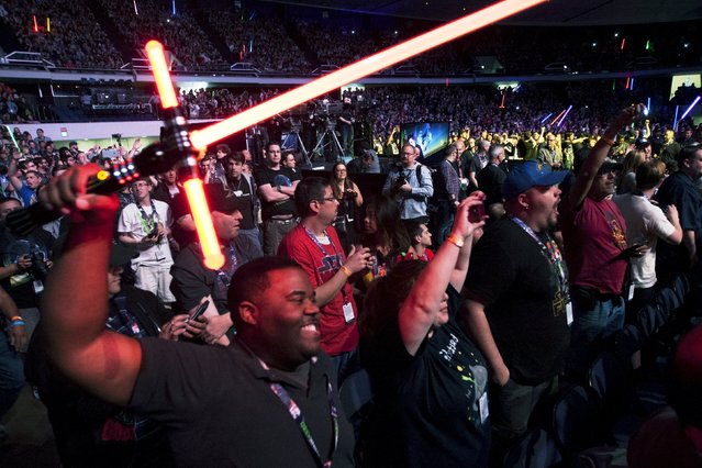 Fans cheer at the kick-off event of the Star Wars Celebration convention in Anaheim, California, April 16, 2015. (Photo by David McNew/Reuters)
