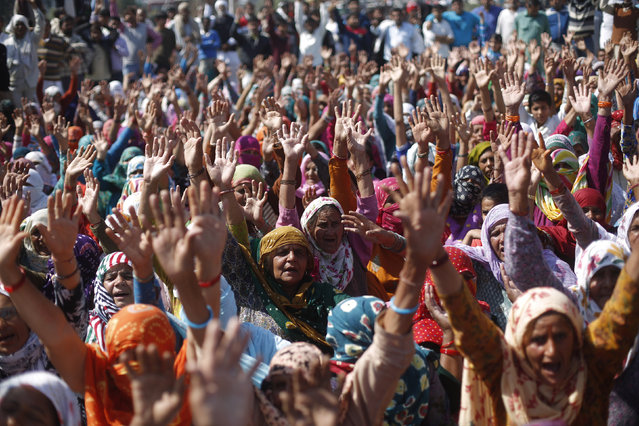 Demonstrators from the Jat community shout slogans as they block the Delhi-Haryana national highway during a protest at Sampla village in Haryana, India, February 22, 2016. Rural Indian protesters blockaded highways and paralysed a northern state on Monday despite a deal giving them more government jobs, but there was relief for New Delhi's 20 million residents as the army retook control of their main water source. (Photo by Adnan Abidi/Reuters)