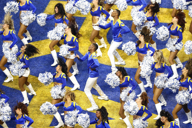 Los Angeles Rams cheerleaders including the first two male cheerleaders in Super Bowl history (C) perform in the third quarter of Super Bowl LIII between the New England Patriots and the Los Angeles Rams at Mercedes-Benz Stadium in Atlanta, Georgia, USA, 03 February 2019. (Photo by Mike Zarrilli/EPA/EFE)