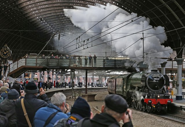 The Flying Scotsman steam locomotive, painted in its traditional colours, passes through York, England, Tuesday February 23, 2016, for a test run to Scarborough ahead of its inaugural journey from London's Kings Cross to York later this week. The locomotive was originally built in Doncaster for the London and North Eastern Railway, and entered service in 1923. (Photo by Owen Humphreys/PA Wire via AP Photo)