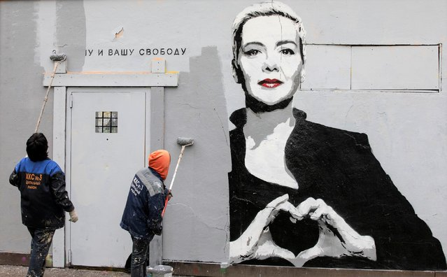 """On the morning of Wednesday, September 8, a graffiti mural depicting imprisoned Belarusian opposition leader Maria Kolesnikova appeared in a St. Petersburg park. The portrait, which showed Kolesnikova making a heart shape with her hands – one of the symbols of the Belarusian opposition – was accompanied by the words """"For our freedom and yours"""". Utility workers painted over the mural within a matter of hours. On Monday, September 6, Kolesnikova was handed an 11-year prison sentence on charges of calling for actions that threaten the national security of Belarus, conspiring to seize power illegally, and creating an extremist group. Lawyer Maxim Znak, another prominent member of the Belarusian opposition who was tried alongside Kolesnikova, was sentenced to 10 years behind bars. (Photo by Reuters/Stringer)"""