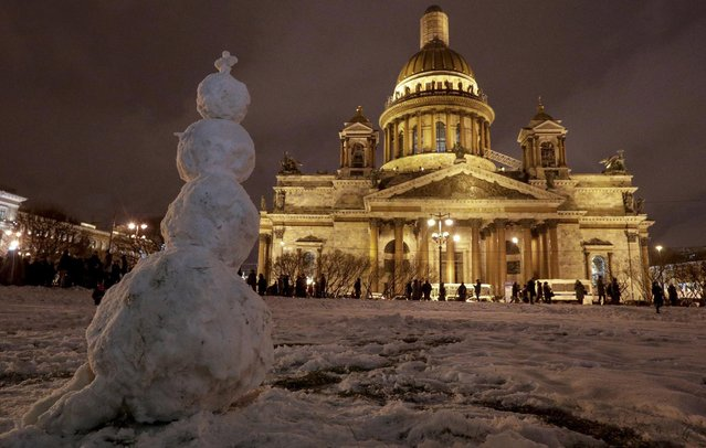 In this Friday, January 13, 2017 file photo a snowman stands in front of the St. Isaac's Cathedral in St.Petersburg, Russia. The Hermitage Museum Director Mikhail Piotrovsky  has urged the head of the Russian Orthodox Church in a letter Wednesday Jan. 25 2017,  to recall its bid for a landmark St. Petersburg cathedral. Several hundred people have rallied outside the iconic St. Isaac's Cathedral earlier this month, fearing that its transferal from the city to the church may inhibit public access. (Photo by Dmitri Lovetsky/AP Photo)