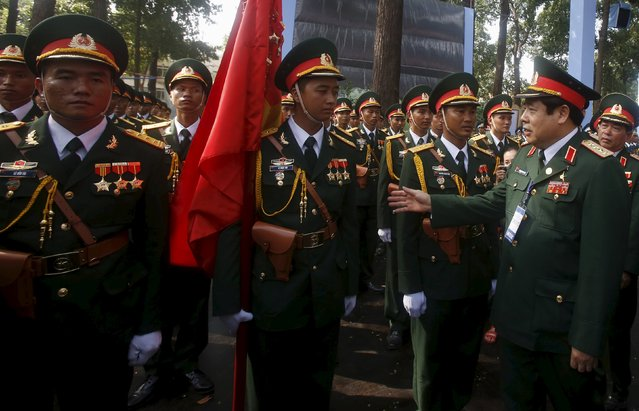 Vietnam's Defence Minister General Phung Quang Thanh (R) talks with soldiers attending a rehearsal for a military parade as part of the 40th anniversary of the fall of Saigon in southern Ho Chi Minh City (formerly Saigon City), Vietnam, on April 26, 2015. (Photo by Reuters/Kham)