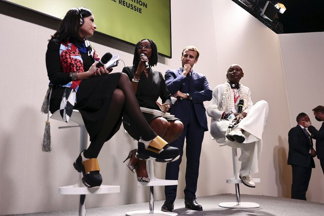 French President Emmanuel Macron attends a conference at the Benin stand to speak about restitutions of African heritage at the New Africa-France 2021 Summit in Montpellier, France, Friday, October 8, 2021. (Photo by Sarah Meyssonnier, Pool Photo via AP Photo)