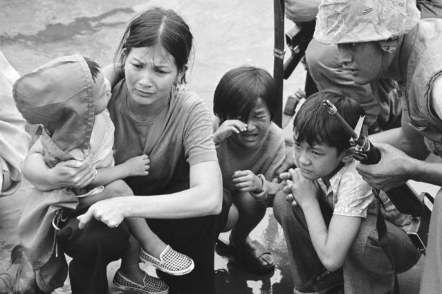 A weeping South Vietnamese mother and her three children are shown on the deck of this amphibious command ship being plucked out of Saigon by U.S. Marine helicopters in Vietnam, April 29, 1975. (Photo by AP Photo)