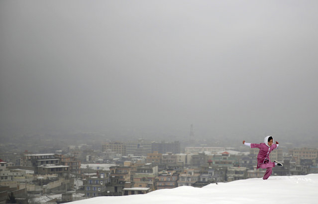 A Shaolin Wushu martial arts student practices on a hilltop in Kabul, Afghanistan, Tuesday, January 25, 2017, preparing for the day that Afghanistan can send its women's team to the Shaolin world championship in China. (Photo by Massoud Hossaini/AP Photos)