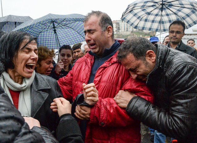 Family members and relatives grieve for victims of a car bombing outside the forensic morgue on March 14, 2016 in Ankara, Turkey. At least 37 people were killed and 125 people injured when a car bomb exploded on March 13th in the busy square in Turkish capital of Ankara. (Photo by Gokhan Tan/Getty Images)
