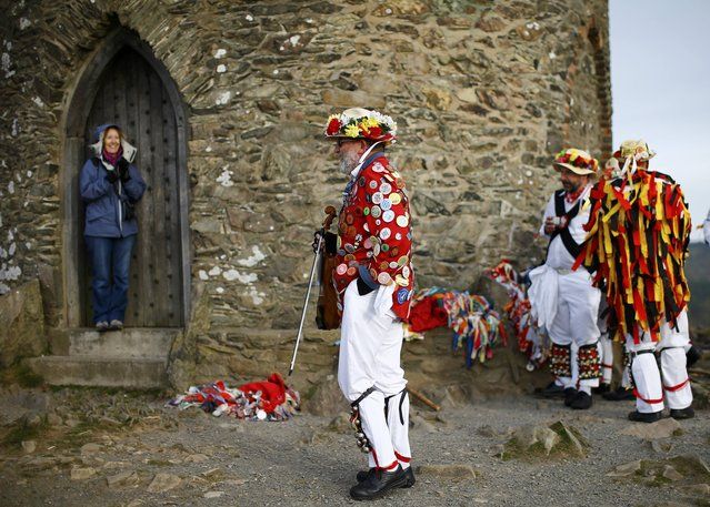 Leicester Morrismen rest between dances during May Day celebrations at Bradgate Park in Newtown Linford, Britain May 1, 2015. (Photo by Darren Staples/Reuters)