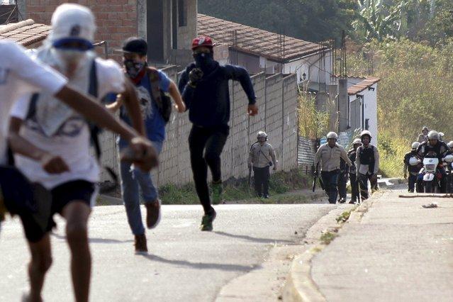 Student demonstrators run away from police during a protest against Venezuelan President Nicolas Maduro's government in San Cristobal, Venezuela, March 10, 2016. (Photo by Carlos Eduardo Ramirez/Reuters)