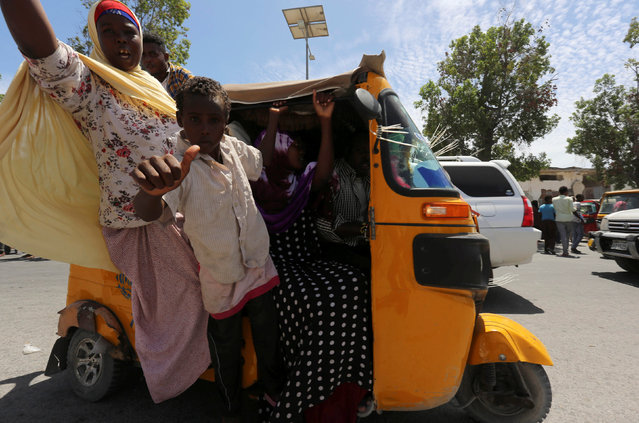 Civilians ride in a rickshaw as they celebrate the election of President Mohamed Abdullahi Mohamed in the streets of Somalia's capital Mogadishu, February 9, 2017. (Photo by Feisal Omar/Reuters)