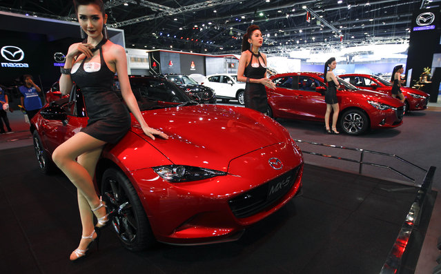 A model poses beside a Mazda MX-5 during a media presentation at the 37th Bangkok International Motor Show in Bangkok, Thailand, March 22, 2016. (Photo by Chaiwat Subprasom/Reuters)