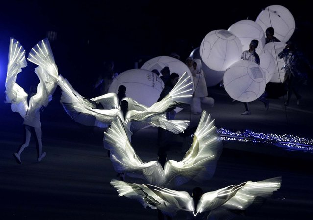 South Korean artists perform during the closing ceremony. The 2018 Winter Olympics will be held in South Korea. (Photo by Matthias Schrader//Associated Press)