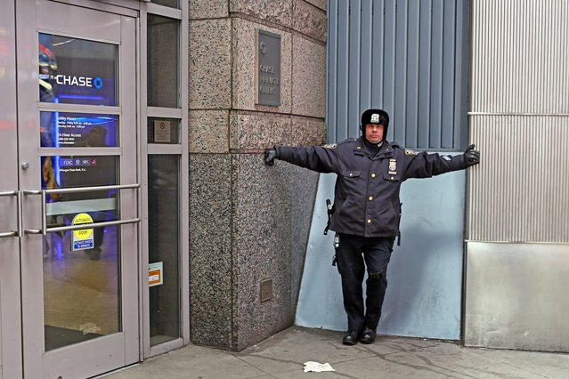 """Cop Holds Up Bank"". (Rich Docherty)"