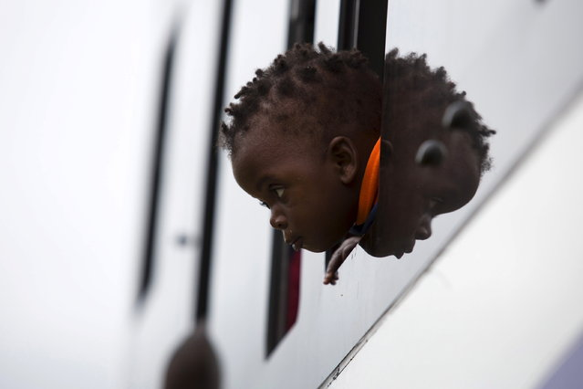 A child from Zimbabwe waits for a bus to depart for Harare, from a camp for those affected by anti-immigrant violence in Chatsworth, north of Durban April 19, 2015. (Photo by Rogan Ward/Reuters)