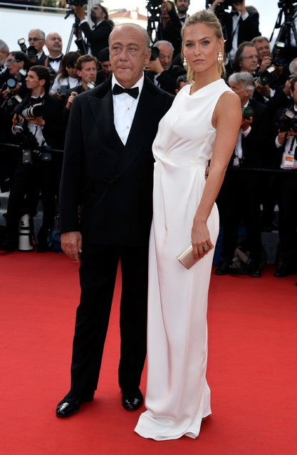 """De Grisogono President and Founder Fawaz Gruosi and model Bar Refaeli attend the opening ceremony and premiere of """"La Tete Haute"""" (Standing Tall) during the 68th annual Cannes Film Festival on May 13, 2015 in Cannes, France. (Photo by Pascal Le Segretain/Getty Images)"""