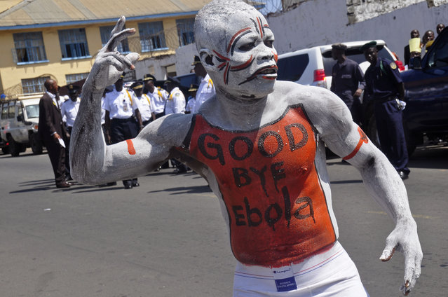 A man takes part in the celebrations, to mark Liberia being an Ebola free nation in Monrovia, Liberia, Monday, May 11, 2015. Liberians are gathering in the streets of the capital to celebrate the end of the Ebola epidemic in this West African country. Monday's festivities come after the World Health Organization declared over the weekend that Liberia was finally Ebola-free. (Photo by Abbas Dulleh/AP Photo)