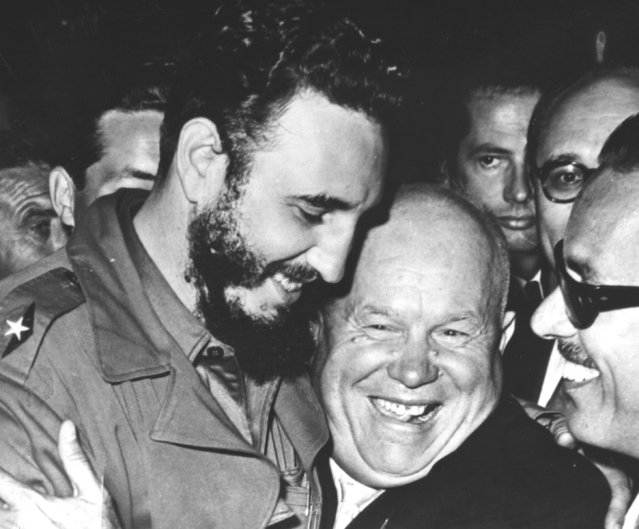 Cuban Prime Minister Fidel Castro, left, is embraced by Soviet Premier Nikita Khrushchev in the United Nations General Assembly on September 20, 1960. The two men are included in the rogues' gallery of unsavory world leaders who have visited New York for the U.N. General Assembly. (Photo by Marty Lederhandler/AP Photo)