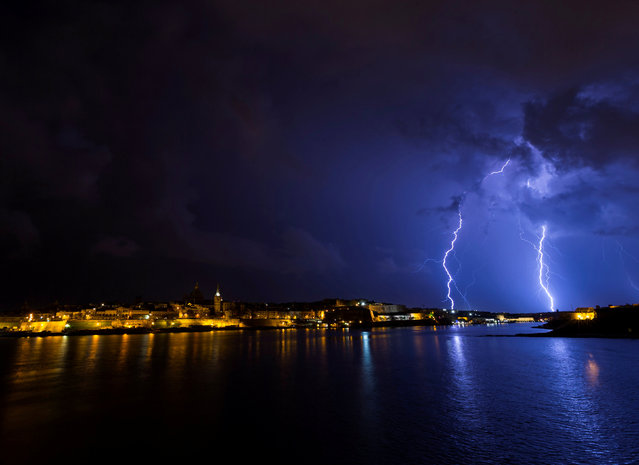 Lightning bolts are seen during a storm over Valletta, Malta October 22, 2018. (Photo by Darrin Zammit Lupi/Reuters)