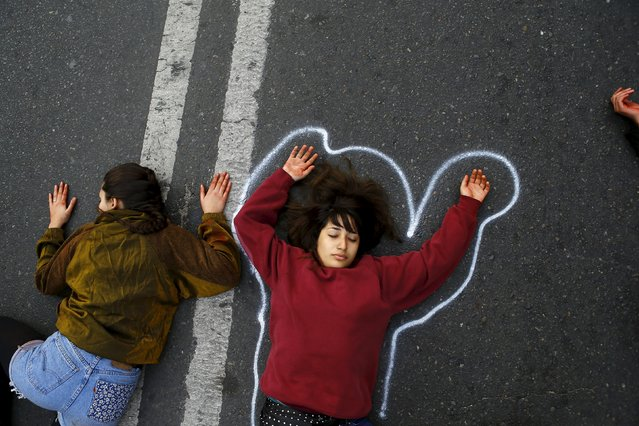 Demonstrators lie on the floor pretending to be dead, in reference to a student shot dead on May 14 after a protest march, during a rally, as Chile's President Michelle Bachelet delivers a speech inside the National Congress, in Valparaiso city, May 21, 2015. (Photo by Ivan Alvarado/Reuters)
