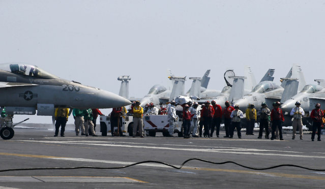 Fighter jets on board the US Navy aircraft carrier USS Carl Vinson (CVN 70) are prepared for patrols off the disputed South China Sea Friday, March 3, 2017. (Photo by Bullit Marquez/AP Photo)