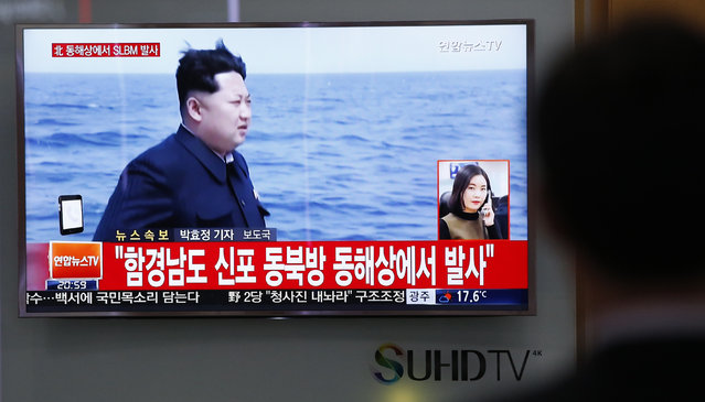 """A man watches a TV news program showing a file footage of North Korean leader Kim Jong Un at the Seoul Train Station in Seoul, South Korea, Saturday, April 23, 2016. North Korea on Saturday fired what appeared to be a ballistic missile from a submarine off its northeast coast, South Korean defense officials said, Pyongyang's latest effort to expand its military might in the face of pressure by its neighbors and Washington. The Korean letters read: """"North Korea fires submarine-launched ballistic missile or SLBM"""". (Photo by Lee Jin-man/AP Photo)"""