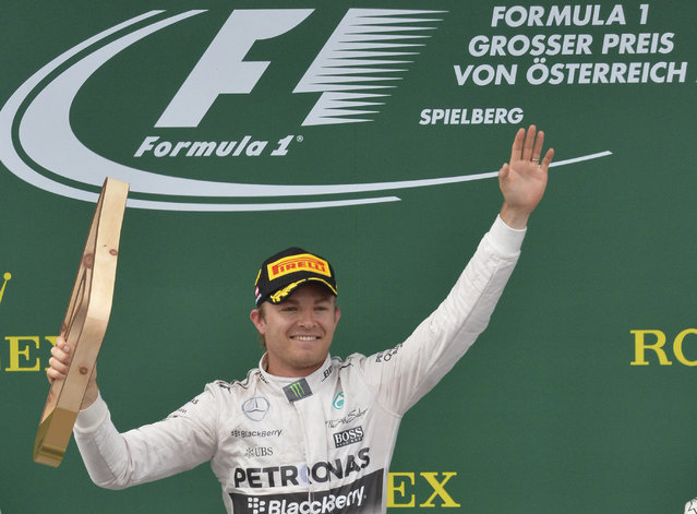 Mercedes driver German's Nico Rosberg celebrates his victory following the Austrian Formula One Grand Prix race at the Red Bull Ring in Spielberg, southern Austria, Sunday, June 21, 2015. (AP Photo/Kerstin Joensson)
