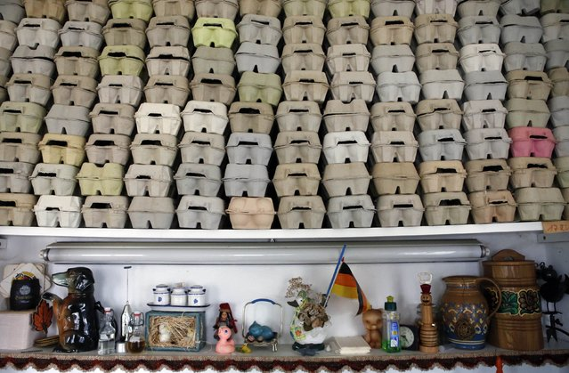 Egg boxes for storing Easter eggs are stacked in a room of German pensioners Christa and Volker Kraft's summerhouse in the eastern German town of Saalfeld, March 19, 2014. (Photo by Fabrizio Bensch/Reuters)