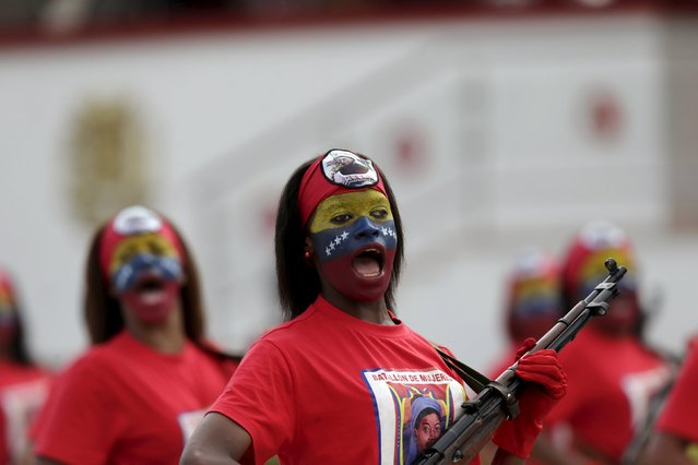 Female soldiers with their faces painted in the colours of the Venezuelan flag, march during a military parade to celebrate the anniversary of Venezuela's independence in Caracas, July 5, 2015. (Photo by Jorge Dan Lopez/Reuters)