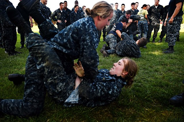 Members of the United States Naval Academy freshman class ground fight during the annual Sea Trials training exercise at the U.S. Naval Academy on May 13, 2014 in Annapolis, Maryland. (Photo by Patrick Smith/Getty Images)