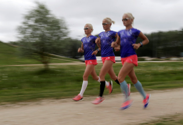 Estonia's olympic team female marathon runners triplets (L-R) Lily, Liina and Leila Luik run during a training session in Tartu, Estonia, May 26, 2016. Leila, Liina and Lily Luik will make Olympics history as the first identical triplets to compete against each other when they cross the start line for the women's marathon in Rio. (Photo by Ints Kalnins/Reuters)