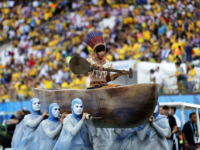 Dancers perform during the opening ceremony prior to the FIFA World Cup 2014 group A preliminary round match between Brazil and Croatia at the Arena Corinthians in Sao Paulo, Brazil, 12 June 2014. (Photo by Tolga Bozoglu/EPA)