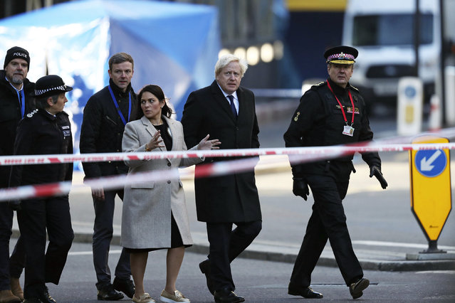 Britain's Prime Minister Boris Johnson, second right, Home Secretary Priti Patel, center, and Metropolitan Police Commissioner, Cressida Dick, left, attend the scene in central London, Saturday, November 30, 2019, after an attack on London Bridge on Friday. UK counterterrorism police on Saturday searched for clues into how a man imprisoned for terrorism offenses before his release last year managed to stab several people before being tackled by bystanders and shot dead by officers on London Bridge. Two people were killed and three wounded. (Photo by Steve Parsons/PA Wire via AP Photo)