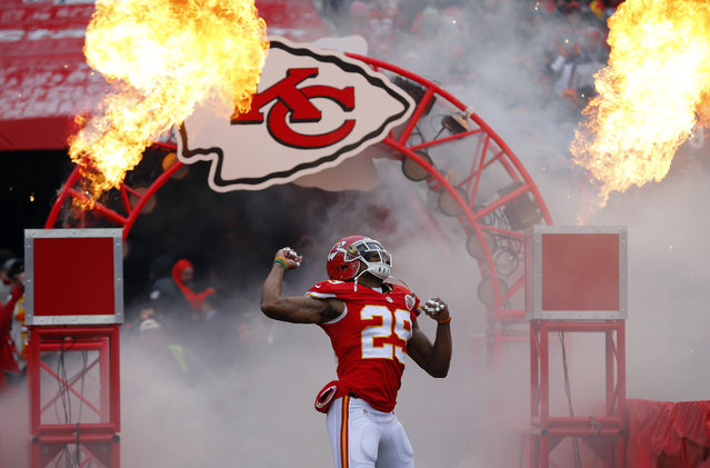 In this November 16, 2014, file photo, Kansas City Chiefs strong safety Eric Berry enters the field prior to an NFL football game against the Seattle Seahawks in Kansas City, Mo.  Berry, cleared by the Kansas City medical staff and his own doctors after a battery of tests Tuesday, July 28, 2015, is returning to the practice field, less than eight months after a stunning cancer diagnosis threatened to derail his Pro Bowl career. (Photo by Ed Zurga/AP Photo)