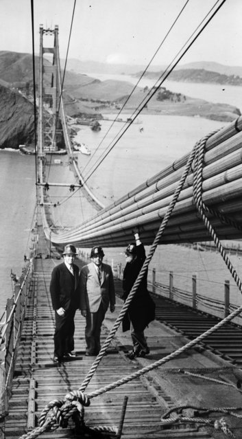 Chief Engineer of National Parks Frank Kettredge with his chief counsel George H. Harlan on the Golden Gate suspension bridge in San Francisco, 1937. (Photo by Fox Photos/Getty Images)