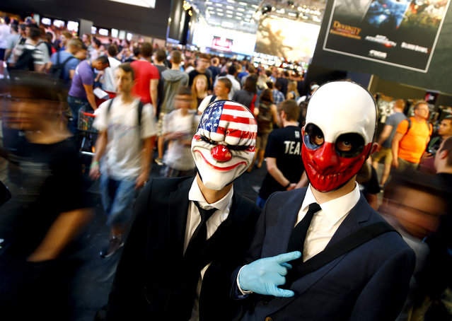 Cosplayers pose for a photo during the Gamescom 2015 fair in Cologne, Germany August 6, 2015. (Photo by Kai Pfaffenbach/Reuters)