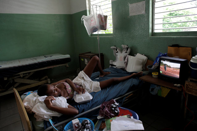 Mirlene Verdieu watches television as she rests in a room at the Hospital of the State University of Haiti, which is one of the centers affected by a three-month-long strike by health workers demanding a pay rise and resources, in Port-au-Prince, Haiti, June 20, 2016. (Photo by Andres Martinez Casares/Reuters)