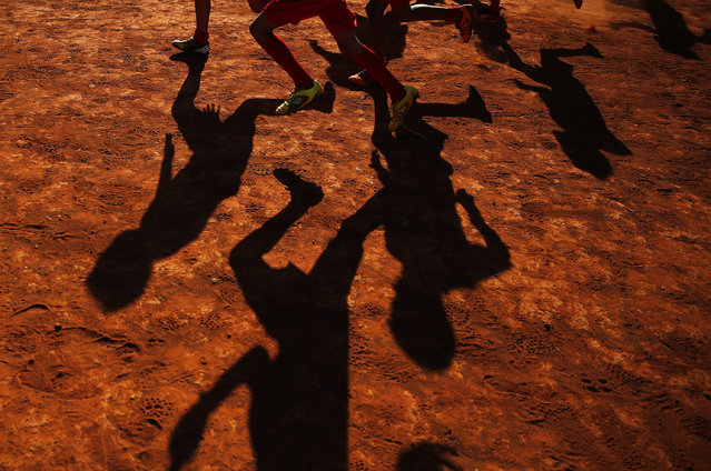 """Young players of Planaltina football club practise in Planaltina July 3, 2014. In a project called """"On The Sidelines"""", Reuters photographers share pictures showing their own quirky and creative view of the 2014 World Cup in Brazil. (Photo by Damir Sagolj/Reuters)"""