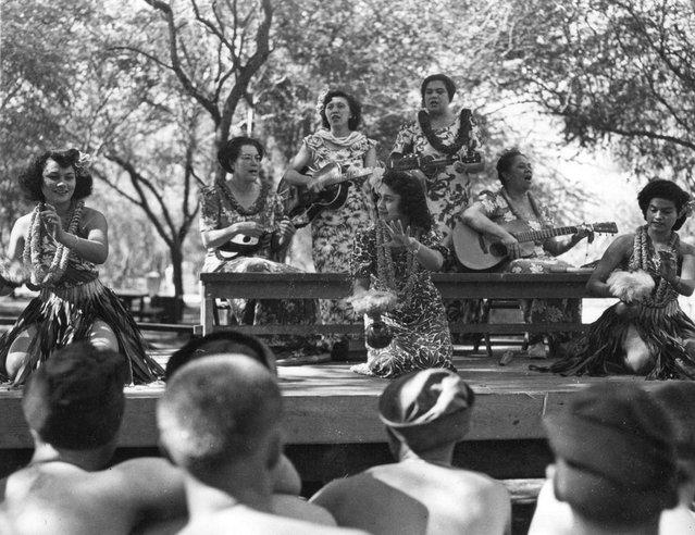 Dorothy Lamours entertain boys with Hawaiian hula