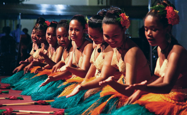 This photo taken on July 29, 2014 shows traditional dancers performing at the opening night of the 45th Pacific Islands Forum in the Palau city of Koror. Pacific island leaders of the 15 nations represented at the Pacific Islands Forum will renew calls this week for meaningful action on climate change at the regional summit, amid fears rising seas will swamp their low-lying nations. (Photo by Richard W. Brooks/AFP Photo)