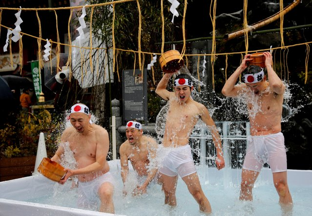 Men splash themselves with cold water during the annual cold water endurance ceremony, to purify their souls and wish for good fortune in the new year, at the Kanda Myojin shrine in Tokyo, Japan, January 18, 2020. (Photo by Kim Kyung-Hoon/Reuters)