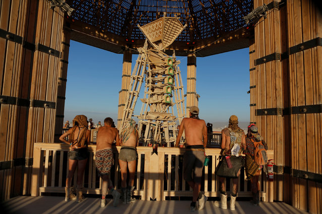 Participants look at the Man as approximately 70,000 people from all over the world gathered for the annual Burning Man arts and music festival in the Black Rock Desert of Nevada, U.S. August 29, 2017. (Photo by Jim Urquhart/Reuters)