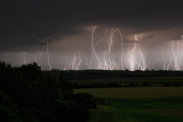 Several same position lightning images stacked. Storms tracking northwest of Omaha produced multiple cloud to ground bolts. (Photo by Mike Hollingshead)