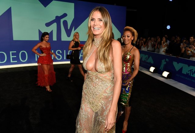 Heidi Klum arrives at the MTV Video Music Awards at The Forum on Sunday, August 27, 2017, in Inglewood, Calif. (Photo by Chris Pizzello/Invision/AP Photo)