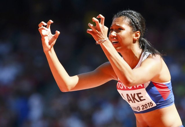 Morgan Lake of Britain gestures as she competes in the women's high jump qualifying round during the 15th IAAF World Championships at the National Stadium in Beijing, China, August 27, 2015. (Photo by David Gray/Reuters)