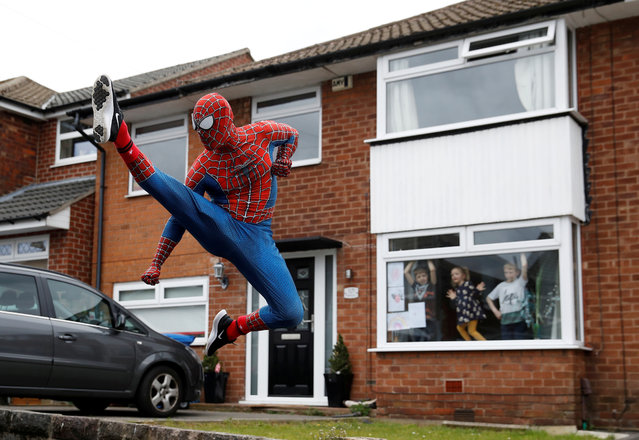 Jason Baird is seen dressed as Spiderman during his daily exercise to cheer up local children in Stockport, as the spread of the coronavirus disease (COVID-19) continues, Stockport, Britain, April 1, 2020. (Photo by Phil Noble/Reuters)