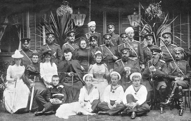 Tsar Alexander III of Russia (1845–1984) and his family in Neuilly-sur-Seine, circa 1890. From left to right, (back row), Sergei Mikhailovich and Nikolai Nicolaievich; (third row) two Dukes of Mecklenburg-Strelitz, Constantin Constantinovich, Queen Olga of Greece, the future Tsar Nicholas II, Vladimir Alexandrovich (the Tsar's brother), Prince Alexander Petrovich von Oldenburg, Dmitri Constantinovich, Peter Alexandrovich von Oldenburg, Georg Maximilianovich von Leuchtenberg; (second row), Grand Duchess Xenia Alexandrovna (the Tsar's daughter), Marie Paulovna (the Tsar's sister-in-law), Grand Duchess Elena Vladimirovna, Alexandra Iosifovna  (the Tsar's aunt), Princess Maria Feodorovna (the Tsar's consort), Tsar Alexander III, Mikhail Nikolaievich, Pavel Alexandrovich; (front row), Alexei Mikhailovich, Grand Duke Mikhail Alexandrovich (the Tsar's son), Andrei and Boris Vladimirovich (the Tsar's nephews). Photograph by the de Jongh Brothers. (Photo by Otto Herschan)