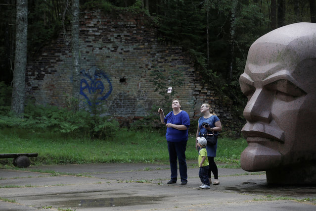 People take a selfie at the abandoned former Soviet R12 nuclear missile launch site in Zeltini, Latvia, July 22, 2016. (Photo by Ints Kalnins/Reuters)