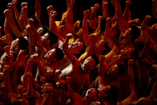 Dancers perform at a gala show to mark the 70th anniversary of the end of World War Two, in Beijing, China, September 3, 2015. (Photo by Kim Kyung-Hoon/Reuters)